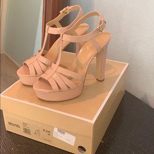Michael Kors patent leather sandal heel.